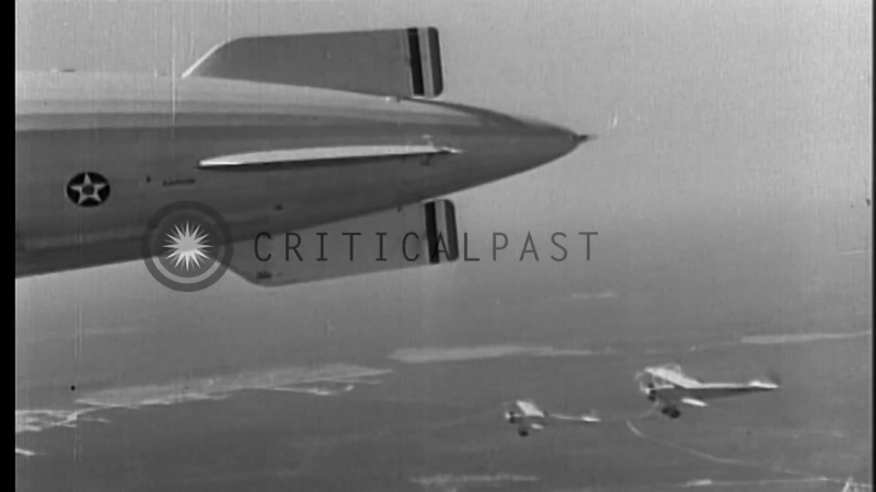Consolidated N2Y-1 hooks on to USS Akron (ZRS-4) Zeppelin Dirigible off the New ...HD Stock Footage
