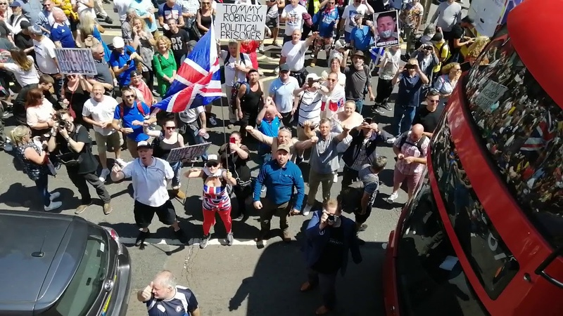 Sentencing Day Tommy Robinson Lokking At The Crowd From The Roof Of The Bus