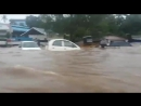 Vehicles floating on the road due to heavy flooding in Wayanad Kerala KeralaFloods