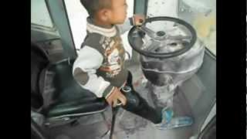5yr old boy drives front loader, video will leave you speechless