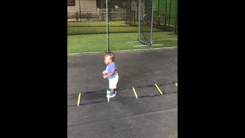 1-year-old putting in work on the ladder drill.