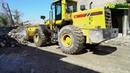 Heli Z1 50E11 Whell Loader cleans material on the road