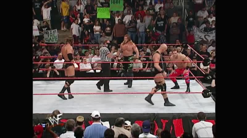 My1 Бенуа и Джерикто против Остина и Трип Эйча за командные титулы на Raw is War