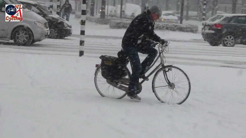 Cycling in the snow Den Bosch Netherlands