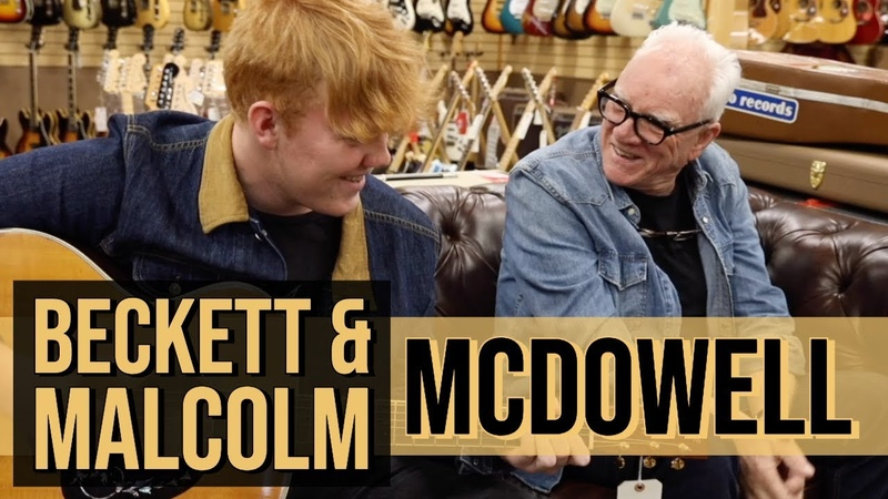 Beckett and Malcolm McDowell at Norman's Rare Guitars